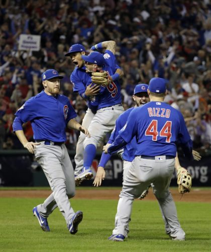 The Chicago Cubs celebrate after Game 7 of the Major League Baseball World Series against the Cleveland Indians Thursday in Cleveland. The Cubs won 8-7 in 10 innings to win the series 4-3 in the team's first title since 1908. (AP photo —David J. Phillip)