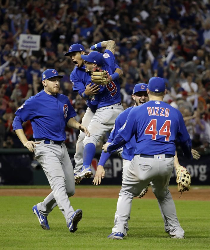 The Chicago Cubs celebrate after Game 7 of the Major League Baseball World Series against the Cleveland Indians Thursday in Cleveland. The Cubs won 8-7 in 10 innings to win the series 4-3 in the team's first title since 1908. (AP photo — David J. Phillip)