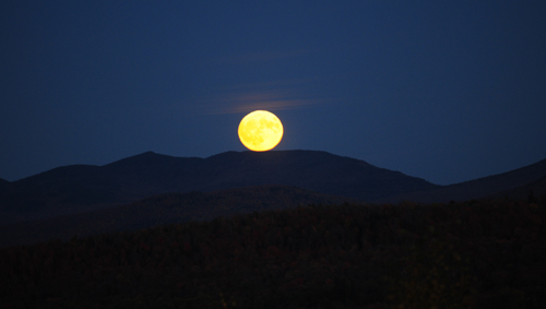 """The """"hunter's moon"""" rises over the mountains on Oct. 15. A historic supermoon will be in the sky Sunday and Monday. (Enterprise photo — Lou Reuter)"""