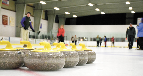 A set of curling stones sits on the ice awaiting play during one of the Lake Placid Curling Club's learn-to-curl events at the Saranac Lake Civic Center. (Enterprise photo — Justin A. Levine)