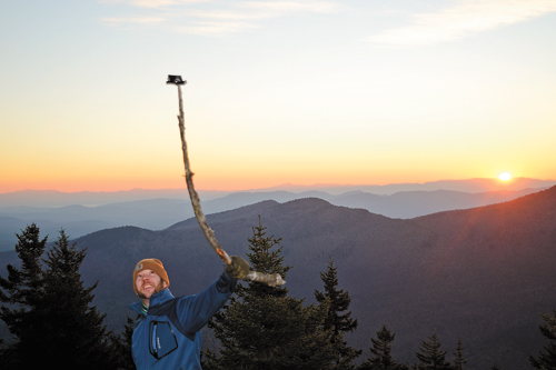 Alec Bieber of Saranac Lake takes a photo of himself with a GoPro camera at the summit of Catamount Mountain in November. (Enterprise photo — Antonio Olivero)