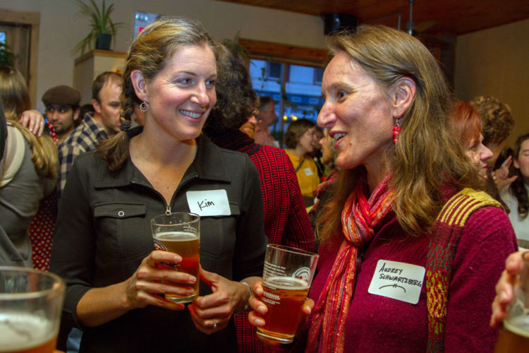 Northern Lights School parent and board member Audrey Schwartzberg, right, chats with another supporter of the Saranac Lake Waldorf school over beers at a celebration of the school's 20th anniversary on Nov. 2 at Bitters & Bones pub in Saranac Lake. (Photo provided — Ezra Schwartzberg)