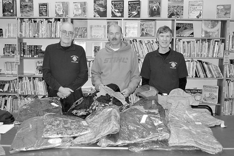 From left, Knights of Columbus Council 599 Financial Secretary Greg Peck, Grand Knight Stuart Darrah and Program Chairman Dan McLean are pictured with coats the organization collected for the Coats for Kids Program. (Photo provided)