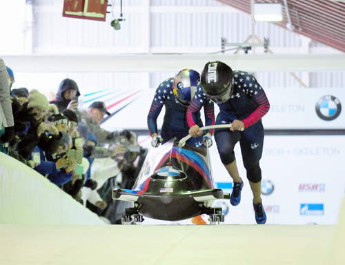 Driver Elana Meyers Taylor and push athlete Lolo Jones, left, start their first run of a World Cup race in December 2016 in Lake Placid. The pair slid to the silver medal. (Enterprise photo — Lou Reuter)