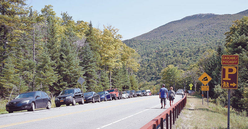 Cars are parked on both sides of state Route 73, near the Cascade Mountain trailhead, on the Sunday of Labor Day weekend in September after the nearby parking areas filled up (Enterprise photo — Justin A. Levine)
