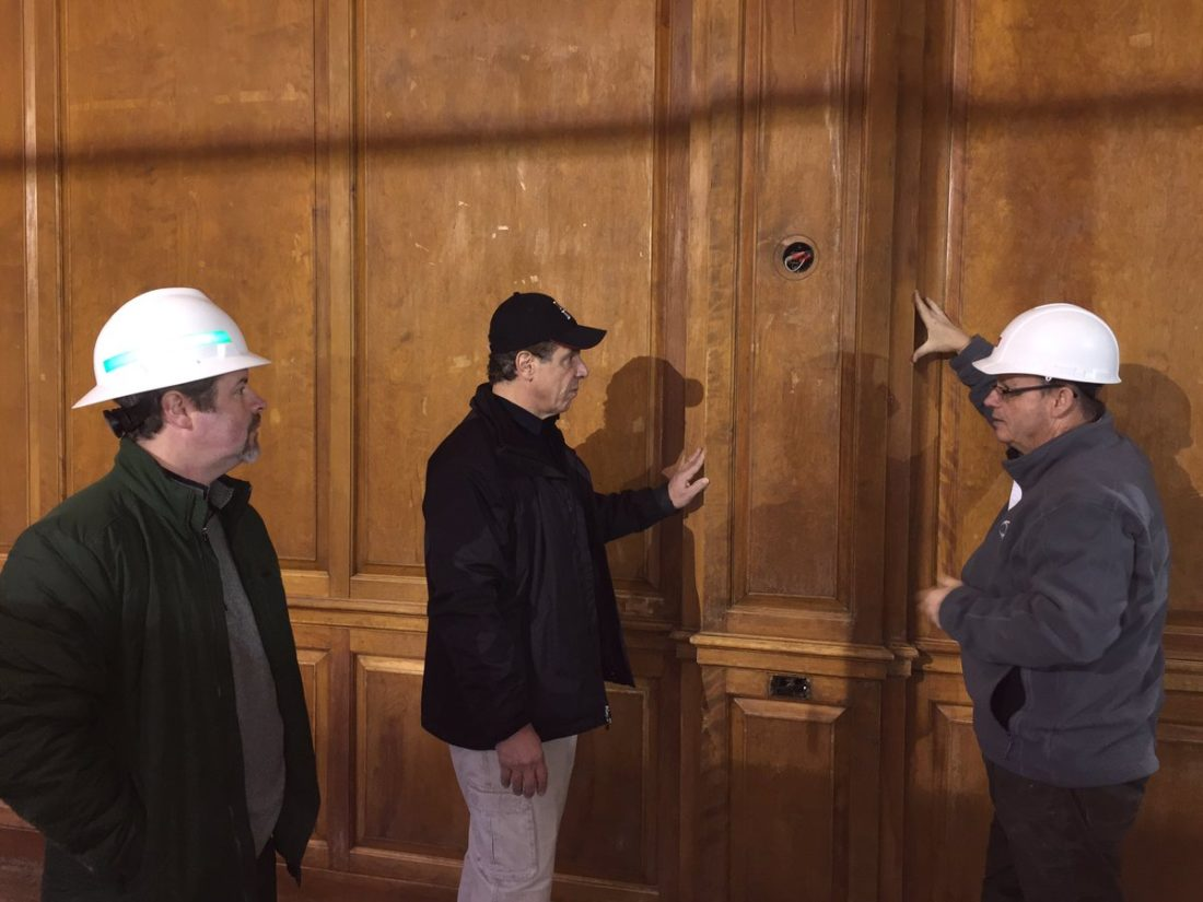 Gov. Andrew Cuomo, center, tours the Hotel Saranac renovation site Tuesday afternoon. With him are project consultant Dan Ott, left, and JNK Home Enterprises Director of Operations Kevin Knobloch. (Photo provided by the governor's office)