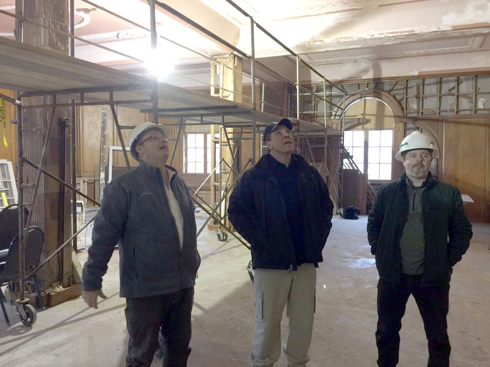 Gov. Andrew Cuomo, center, tours the Hotel Saranac renovation site Tuesday afternoon. With him are project consultant Dan Ott, right, and JNK Home Enterprises Director of Operations Kevin Knobloch. (Photo provided by the governor's office)