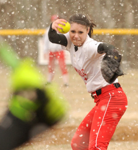 When covering a local high school team playing a non-local opponent, we rarely run a big photo of the other team's player on page A1. On April 13, however, we couldn't help but run this shot of Saranac softball pitcher Nikki Donah winding up to deliver the ball to a Saranac Lake batter amid a mid-game snowstorm. The intensity in her eyes is electric. (Enterprise photo — Lou Reuter)