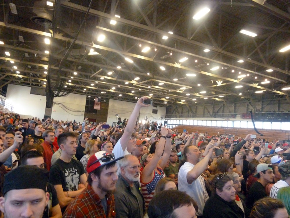 A crowd cheers for presidential candidate Donald Trump at a campaign rally April 15 at the Crete Center in Plattsburgh. (Enterprise photo — Antonio Olivero)