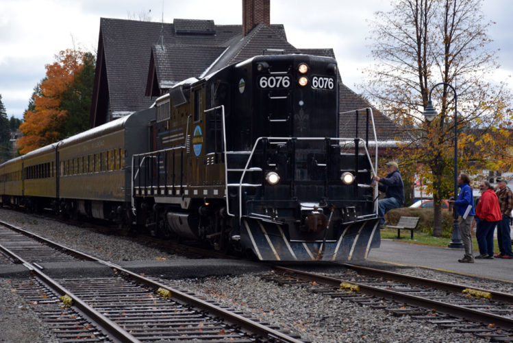 """Rosie,"" one of the Adirondack Scenic Railroad's engines, leaves the Saranac Lake train depot for perhaps the last time in October. (Enterprise photo — Justin A. Levine)"