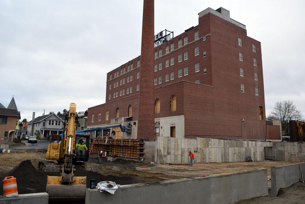 Work proceeds on the Hotel Saranac's new parking garage in November. (Enterprise photo — Chris Knight)