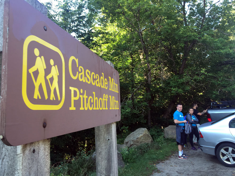 Hikers prepare for a hike at the trailhead of Cascade and Pitchoff mountains. (Enterprise photo — Antonio Olivero)