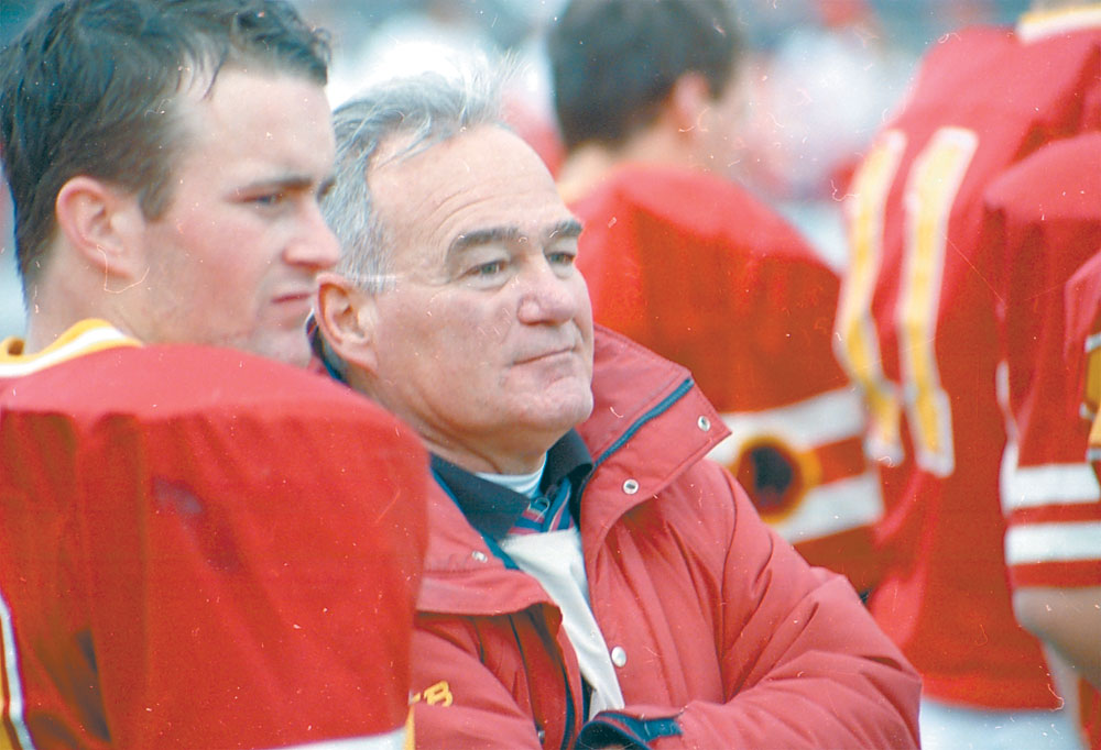 Legendary football coach John Raymond and player Matt Burns look on as the clock winds down on Saranac Lake's 1998 football season during a state semifinal loss to Edgemont at Dietz Stadium in Kingston. It marked the final game Raymond coached after a 25-year career. (Enterprise photo — Lou Reuter)