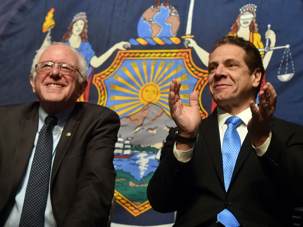 Gov. Andrew Cuomo, right, with U.S. Sen. Bernie Sanders of Vermont, unveil Tuesday the first proposal of the governor's 2017 agenda: making college tuition-free for New York's middle-class families at all SUNY and CUNY two- and four-year colleges. (Photo provided — Kevin P. Coughlin, governor's office)