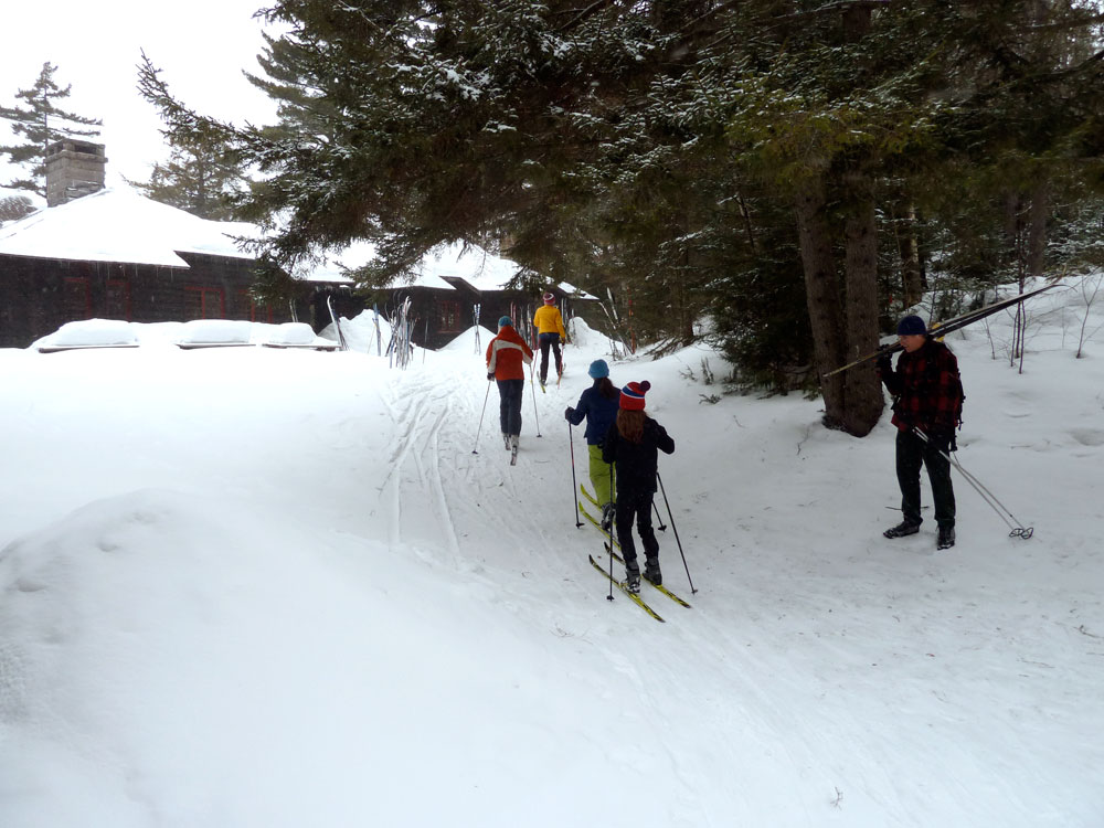 Visitors ski up to Great Camp Santanoni's Main Lodge on a Winter Weekend the state Department of Environmental Conservation hosted in March 2015. (Enterprise photo — Peter Crowley)