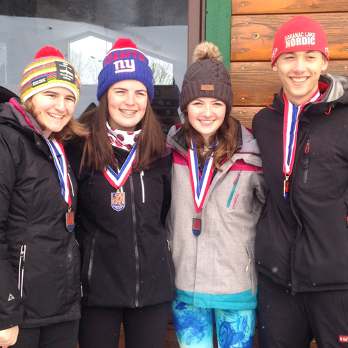 Members of the Saranac Lake High School alpine team pose for a photo after participating in Saturday's Golden Ski Race at Mount Pisgah in Saranac Lake. From left are Erica Swirsky, Ryley Fischer, Relly Fogarty and Witter Swanson. Fischer and Swanson received trophies for recording the fastest times of the day. (Photo provided)