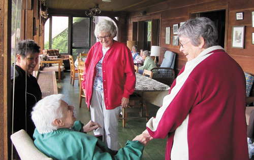 Mercy Care for the Adirondacks volunteers talk with elders at the Mercy Care location in Lake Placid. (Photo provided by Donna Beal)
