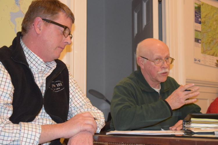 Dean Baker, right, head of the Saranac Lake Winter Carnival Ice Palace building team, speaks at Tuesday's committee meeting, where he announced plans to start construction of the palace on Thursday. Also pictured is Winter Carnival Committee Chairman Jeff Branch. (Enterprise photo — Chris Knight)