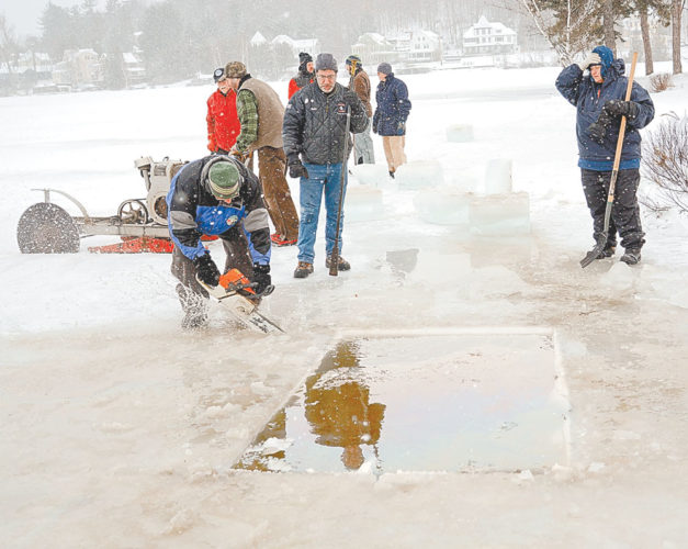Steve Racette uses a chain saw to cut ice blocks from the surface of Lake Flower this morning as construction begins on the Ice Palace for the 2017 Saranac Lake Winter Carnival, which kicks off Feb. 3. Jeff Branch, the Winter Carnival Committee chairman, said crews hope to cut between 500 and 600 blocks of ice from the lake today. The first blocks cut were about one foot thick. (Enterprise photo — Lou Reuter)