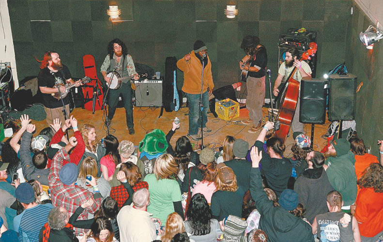 The Blind Owl Band performs at the Waterhole during last year's Saranac Lake Winter Carnival. (Enterprise photo — Lou Reuter)