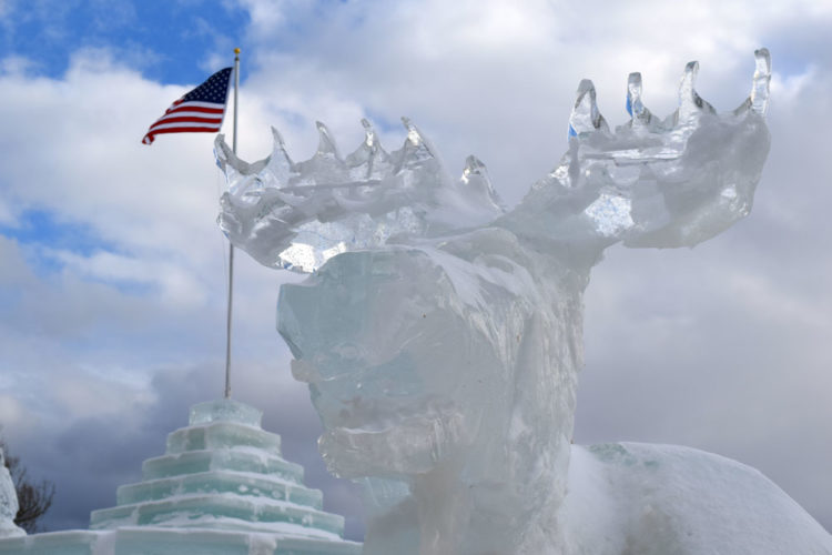 A moose carved in ice stands guard outside the Saranac Lake Winter Carnival Ice Palace Friday afternoon. (Enterprise photo — Chris Knight)