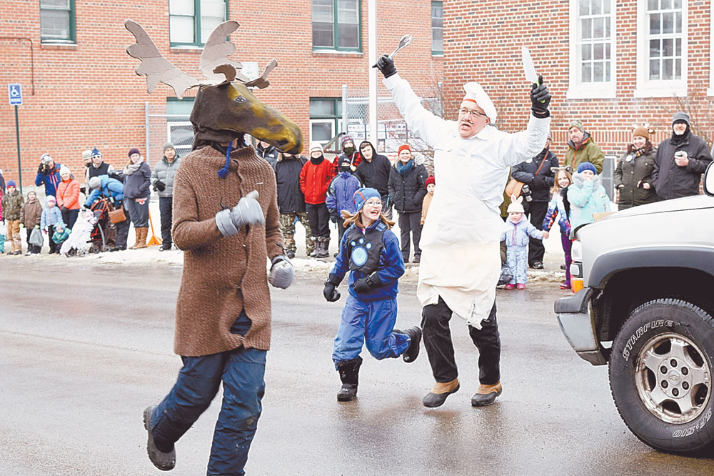 The Kranker family of Saranac Lake — Schuyler as a moose, his sister Summer and their father as an angry chef — won first place among independent group floats in Saturday's Gala Parade, the peak event of the annual Saranac Lake Winter Carnival. (Enterprise photo — Chris Knight)
