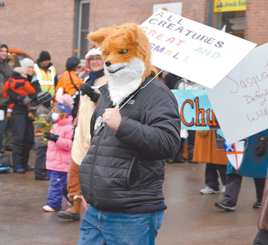 A fox-costumed person marches with the Episcopal Church of St. Luke the Beloved Physician, which won the trophy for best civic/volunteer group float. (Enterprise photo — Chris Knight)