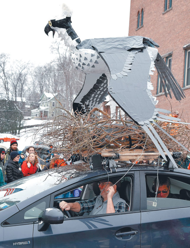 The Adirondack Chapter of the Nature Conservancy's entry included a nesting osprey with moving wings and tail. Co-creators Mark Wilson (driving) and Peter Dupree are in the car controlling the moving limbs. The Nature Conservancy won the trophy for best business group float. (Enterprise photo — Chris Knight)