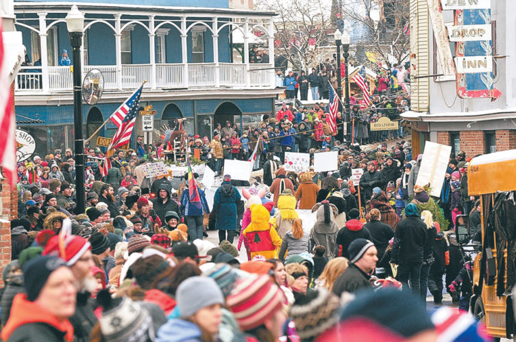 Broadway is packed with people watching the 2016 Saranac Lake Winter Carnival Gala Parade. (Enterprise photo — Lou Reuter)