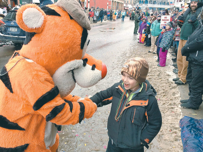 Liam Patnode, 7, is happy to shake hands with Tigger. (Enterprise photo — Don Hare)