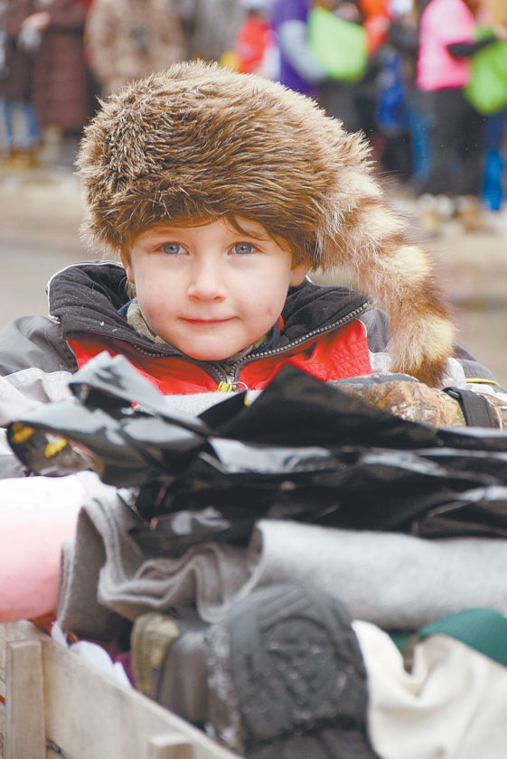 A child wears a coonskin cap in the style of Davey Crockett. (Enterprise photo — Justin A. Levine)