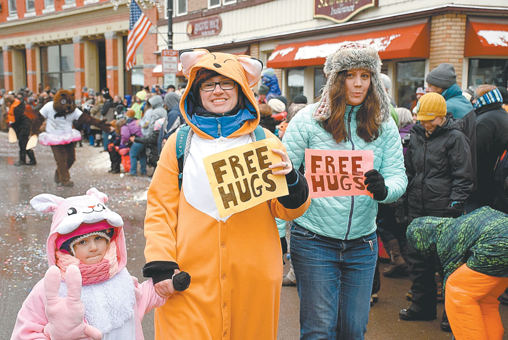 North Country Community College's group offers free hugs. (Enterprise photo — Justin A. Levine)