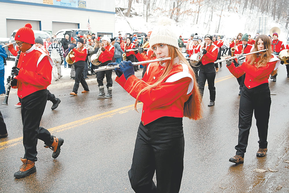 Saranac Lake High School sophomore Ali Finn plays flute with the marching band. At left is freshman Jackson Small; freshman Iyleeh Rose is at right. (Enterprise photo — Lou Reuter)