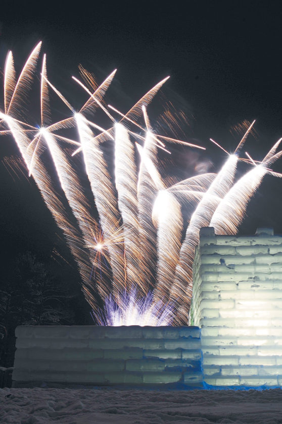 Fireworks streak into the night sky in this photo Sunday from the side of the Saranac Lake Winter Carnival Ice Palace. The fireworks display and the half-hour slide show that preceded it officially brought the 2017 Saranac Lake Winter Carnival to a close. (Enterprise photo — Lou Reuter)