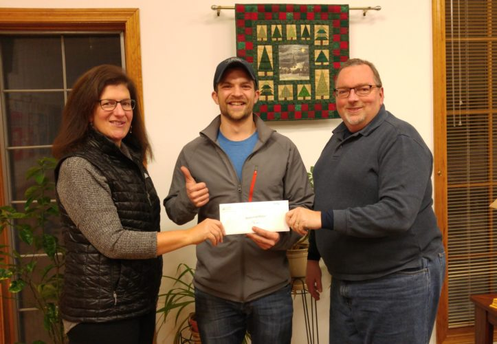 Johnny Williams of Bitters & Bones, center, presents Julie Weinstein and Steve Preston of the Saranac Lake Interfaith Food Pantry Board with a check for $5,056. The gift represents the combined donations of patrons and participants in the second annual Saranac Lake Turkey Trot. The Thanksgiving Day 5K run gathers community members for fun, fitness, and charity. All gifts are used in support of the work of the Food Pantry to address local hunger. For more information, call 518-891-3401 or 518-523-6480. (Photo provided)
