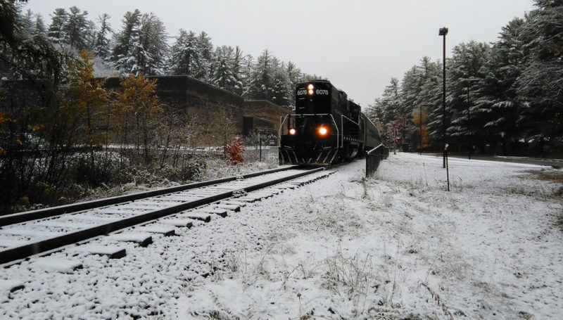An Adirondack Scenic Railroad train travels on Oct. 22 through Saranac Lake's North Country Community College campus, where the land ownership has been in dispute. (Enterprise photo — Morgan Ryan)