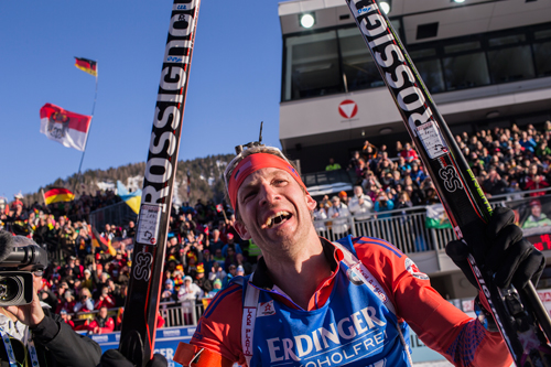 Lowell Bailey celebrates after winning the gold medal in the 20-kilometer individual gold medal Thursday at the biathlon world championships in Hochfilzen, Austria. (Photo — NordicFocus/US Biathlon)
