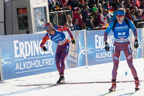 Lowell Bailey crosses the finish line to win the 20-kilometer individual gold medal Thursday at the biathlon world championships in Hochfilzen, Austria. (Photo — NordicFocus/US Biathlon)