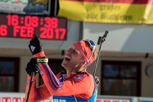Lowell Bailey, of Lake Placid, celebrates his victory in the 20-kilometer individual biathlon race Thursday at the IBU World Championships in Hochfilzen, Austria. (Photo — NordicFocus/US Biathlon)