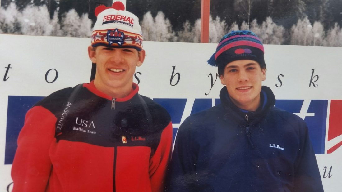 A teenaged Lowell Bailey of Lake Placid, left, and Tim Burke of Paul Smiths smile at their first international biathlon race in the mid 1990s in Torsby, Sweden. Their coach at the time, Kris Cheney-Seymour, keeps this photo on the wall of his office at the Mount Vane Hoevenberg Cross-Country Ski Center outside Lake Placid. (Photo provided — Kris Cheney-Seymour)