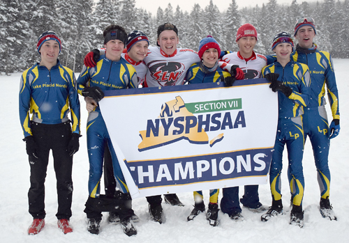 The Section VII championship teams from Lake Placid and Saranac Lake will go on to compete at the NYSPHSAA nordic meet at Bristol Mountain in less than two weeks. From left, Lake Placid's Henry McGrew and James Flanigan, Saranac Lake's Ethan Wood and Jacob Alberga, Lake Placid's Jesse Izzo, Saranac Lake's Lauchlan Cheney-Seymour, and Lake Placid's Kai Franz and Scott Schulz. Missing from the photo is Witter Swanson, of Saranac Lake. (Enterprise photo — Justin A. Levine)