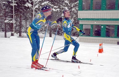 Lake Placid skiers Henry McGrew, left, and Scott Schulz cross the finish line together Thursday afternoon at Mount Van Hoevenberg. (Enterprise photo — Justin A. Levine)