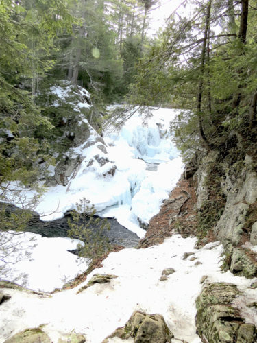 Although snow cover is meager, many of the mountain streams and brooks have retained ice. (Photo — Joe Hackett)