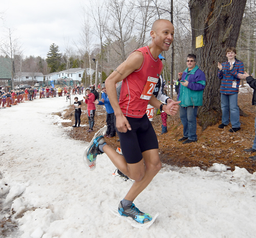 Realizing a world championship title is literally just around the corner, Joseph Gray of Colorado beams while closing in on the finish line during Saturday's 8-kilometer race at Dewey Mountain.  (Enterprise photo — Lou Reuter)