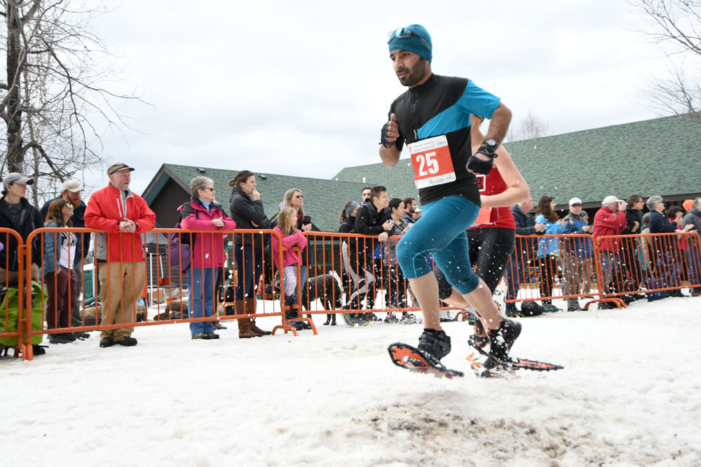 Tanveer Hussain of India races in the World Snowshoe Championships Feb. 25 in Saranac Lake. (Enterprise photo — Lou Reuter)