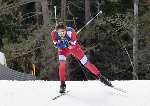 University of Vermont skier Karl Schulz, of Lake Placid, crests the first hill in the men's U20 10K race Monday in Lake Placid. Schulz went on to win the Junior National race by one-tenth of a second. (Enterprise photo — Justin A. Levine)