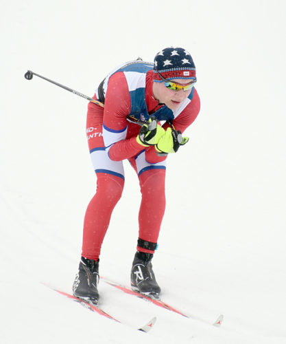 NYSEF skier Ethan Wood, of Saranac Lake, tucks through the first turn of the under-18 10-kilometer race Friday in the XC Junior National Championships at the Olympic Jumping Complex in Lake Placid. (Enterprise photo — Justin A. Levine)