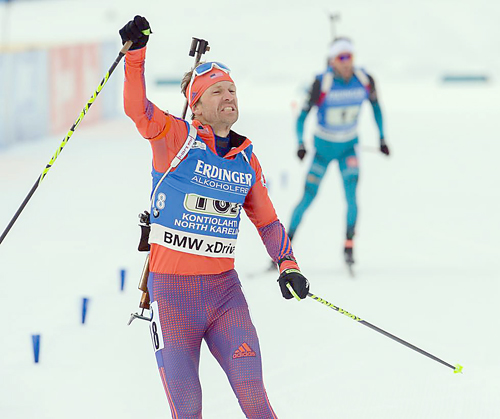 Lowell Bailey, of Lake Placid, crosses the finish line to lock up a silver medal in the single mixed relay race Sunday in Kontiolahti, Finland. (Photo — U.S. Biathlon/Nordic Focus)