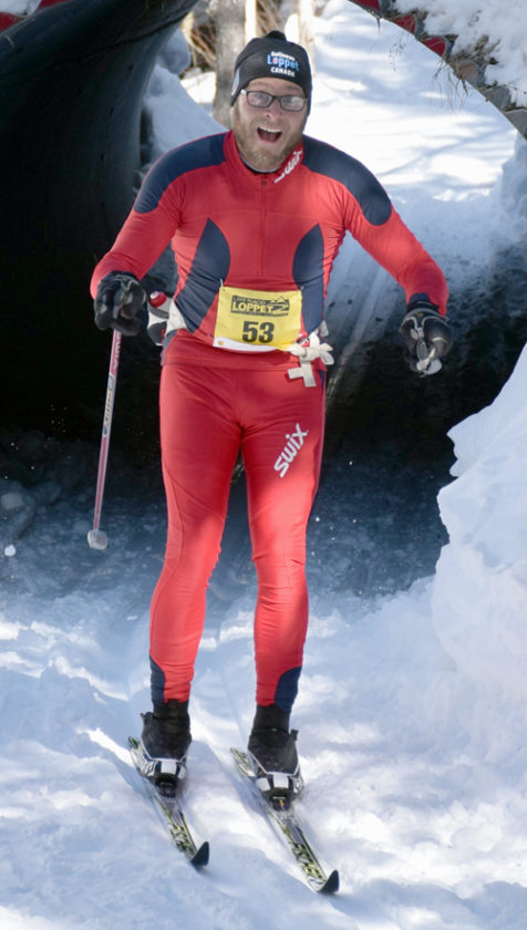 Saranac Lake High School nordic ski coach Keith Kogut is all smiles during Saturday's 50K Loppet classic race. He finished seventh in 3:48:31.  (Enterprise photo — Justin A. Levine)