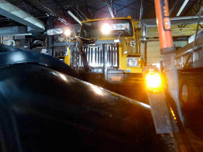 A new flashing LED light has been installed on the blade of each Harrietstown plow truck so oncoming drivers can see how close the plow edge is to them. This one is seen inside the town highway garage on March 23. (Enterprise photo — Peter Crowley)